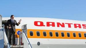 John Travolta helping to launch the new Qantas 'Retro' aircraft November 2014